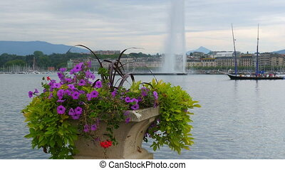 """jet d'eau fountain and flowers at geneva lake, switzerland"""