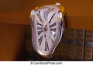 Surreal liquefied clock flowing down table - Liquefied clock...