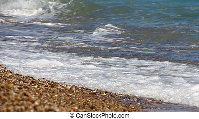 waves of the sea on pebble beach