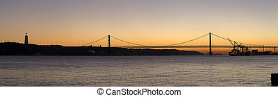 Sunset view of The 25 de Abril Bridge in Lisbon, Portugal