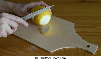 Slicing lemon with the knife