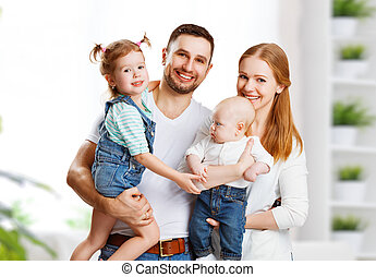 happy family mother, father and children at home