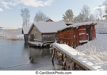 Old boat house, snow and ice in scandinavia