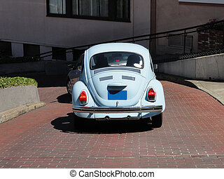 Compact Blue Car - Old rusty car in the Street of Lombard...