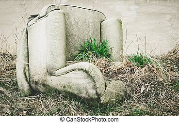 old overturned armchair - A old overturned armchair in...
