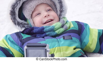 Child on sled in winter - Sitting on sleds smiling baby
