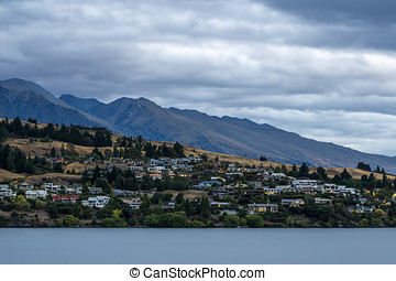 sunset over lake wakatipu with kelvin heights in the...