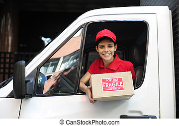delivery courier in truck handing over package - young...