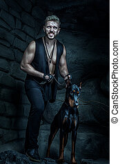 Angry man with a dog Doberman. - Angry man with a dog on a...