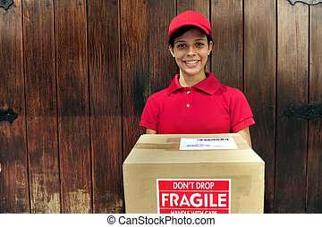 delivery courier with package. copy space - young delivery...