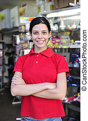teenage girl working part time in a stationery shop