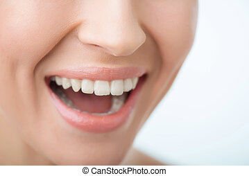 Attractive woman smiling - Stroke of luck. Close up of face...