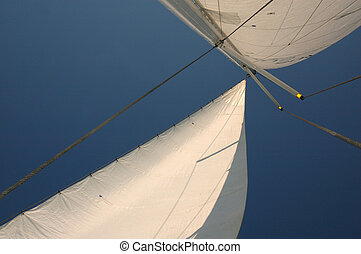 Sail of a boat against blue sky
