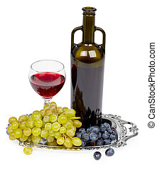 Bottle of red wine, glass and grapes - still life - A bottle...