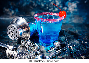 blue cocktail alcoholic drink with fruits and vodka.