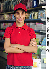 teenage girl working part time in a stationery shop -...