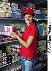 young womanl working in a store - portrait of a young womanl...