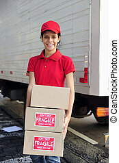 delivery courier or mover delivering cardboards - young...