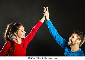 Friends man and woman celebrating giving high five - Man and...