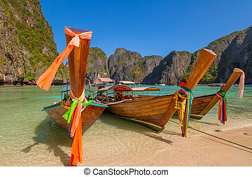 Maya Bay Thailand - Long Tail Boat, traditional wooden...