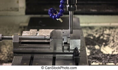 CNC machine milling some steel part