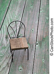 small toy chair on grunge wood background%u3000
