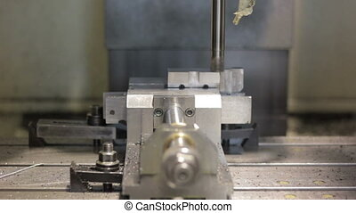Close-up CNC machine milling some steel part.