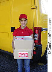 delivery courier or postman delivering cardboards - young...