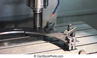 Close-up CNC  Machine milling drilling steel part