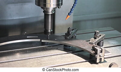 CNC milling machine drilling hole in stiil part.
