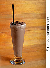 chocolate milkshake drink on wooden board