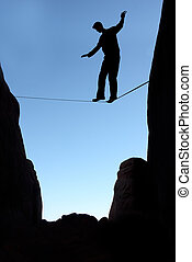 Man balancing on the rope concept of risk taking and...