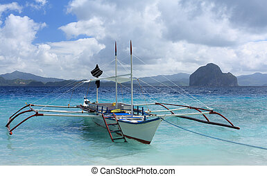 Traditional Philippines boat - Tropica island near El Nido...