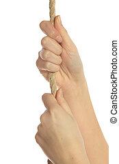 Stiff climb - Human hands using a rope to climb upwards. All...