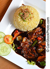Nasi lemak, Asian traditional rice meal on wooden table