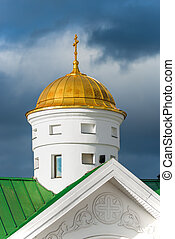 golden dome of an orthodox temple against the sky close-up