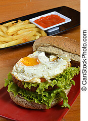 Burger with black pepper and French fries