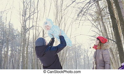 father throw his son in to the sky in winter park slowmotion...