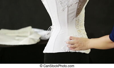 Corset lacing in the manufacturing plant underwear....
