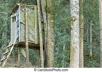 An elevated wooden platform known as Tree stand or Deer...