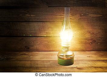 Lamp - Old kerosene lamp on wooden table