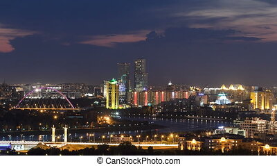 Elevated night view over the city center and central business district with bridge and river Timelapse from rooftop, Kazakhstan, Astana