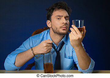 Drunk man drinking alcohol at the table - Sophisticated...