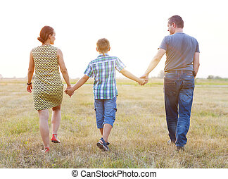 Young family with little son outdoors
