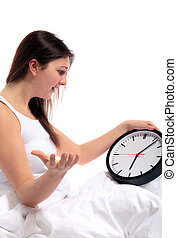 Whining about wake up times - A young woman sitting in her...
