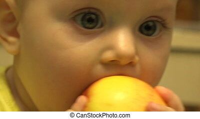 Cute Baby Eating an Apple, First Teeth. First Try to...