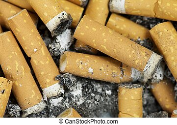 butts - closeup of a pile of cigarette butts off