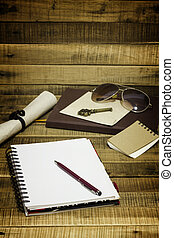 notepaper and pen on wooden background for texture