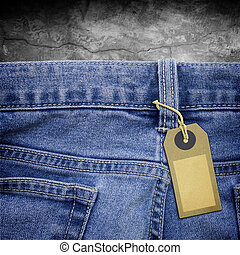 Tag lable on jeans fabric background