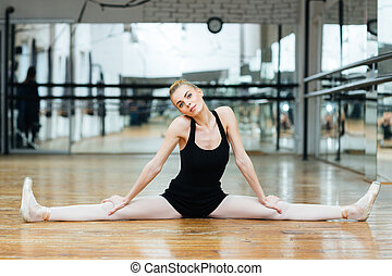 Ballerina doing splits - Lovely ballerina doing splits in...